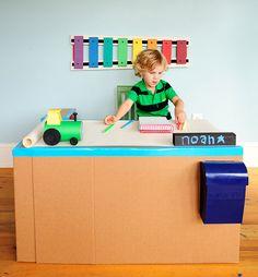 Make A Fun Cardboard Pop-Up Desk Using Binder Clips + Duct Tape.