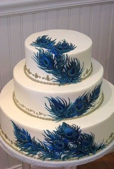 For that Peacock-themed wedding/party, this would be a beautiful cake decoration