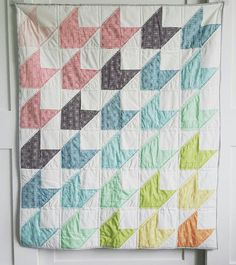 Over the Rainbow Arrows!  This beautiful handmade crib quilt is a welcome addition to any nursery or suits any toddlers décor. Made from designer