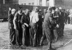Kaunas, Lithuania, Lithuanians splashing water on Jews before murdering them, June 1942.