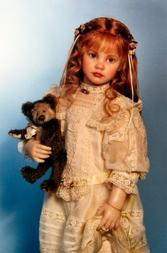 doll with teddy bear. Can you believe this is a doll?!! I want to copy the dress dress.