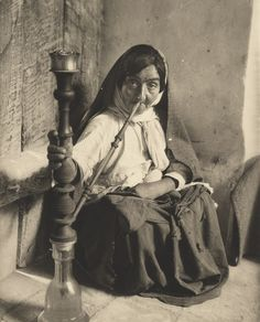 "Woman Smoking a Water Pipe,  Damghan, Iran, 1932, from ""Exploring Iran: The Photography of Erich F. Schmidt."" The show is available for travel from the Penn Museum in Philadelphia."