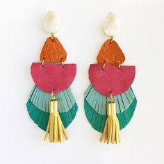 Earrings gold plated and turquoise and khaki soft leather triangles.