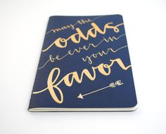 Hunger Games Notebook . Large Navy Moleskine with Gold Ink Calligraphy . May the Odds Be Ever in Your Favor