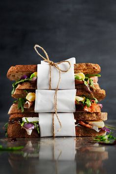 brie and prosciutto sandwiches, all wrapped up - the art of cheese | designlovefest