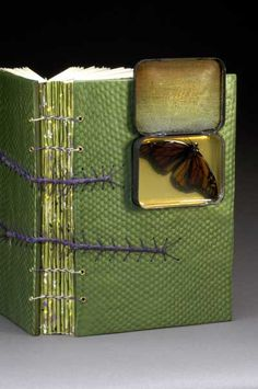 "The last pinner mentioned: ""Monarch butterfly cradled in a metal tin"" And forgot to hype the really awesome book it's attached to. :D"