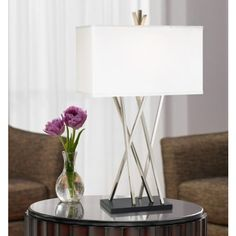 ($130) Possini Euro Design Asymmetry Table Lamp.  Reviews say impossible to turn off and on due to location of the switch. And not 3-way!