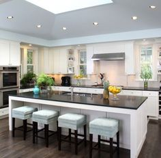 Double oven, long island seated style (very nice) with double sink in the centre. A bit cluttered in counter elements but the natural light, spot lighting in the roof and large cooking space works well. #kitchen #design