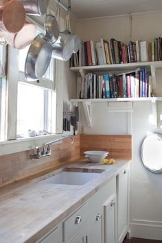 More and more I am drawn to the simple functionality and beauty of the butcher block countertop. I'd run a length of tile or bead board instead of more butcher block for the back splash