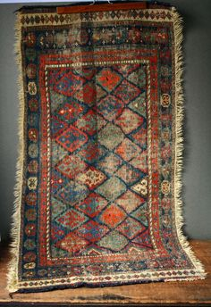 I am attracted to old faded rugs... and this one does not disappoint.