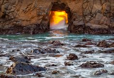 "Neptune's Forge: A magnificent phenomenon to witness. I ordinarily avoid locations that are likely to be crawling with photographers, but I was in the neighborhood of Pfeiffer Beach and decided at the last minute to make an exception. I wanted to do something different than the usual shot of light rays beaming out of the archway and ended up with this fiery, roiling wave making the ""keyhole"" look like the mouth of a raging furnace."