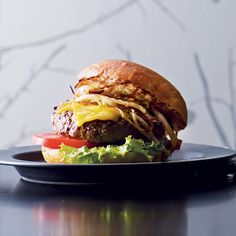 Minetta Burger | Minetta Tavern has become known for its spectacular hamburgers. The restaurant's namesake burger is made with a blend of beef short rib and brisket from the nearly century-old local purveyor Pat La Frieda.