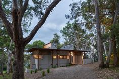 An operable structure that deeply engages with its context, Bay Guarella is a humble home offering shelter and respite amongst its forest surrounds. Peter Stutchbury Architecture combines a rhythmic approach with robust materiality to create a built conduit to the nature the home is immersed within. Nestled into its remote coastal surrounds and suitably named after its location, Bay Guarella occupies a secluded site. #architecture #design #dreamhouse #housegoals