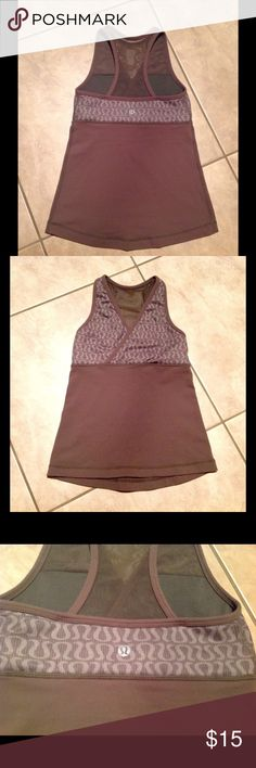 Lululemon tank Used and still pretty good condition. It doesn't fir me anymore so I separated the bra on both sides that helps with the fit some. It's actually more green n not brown. Fit XS 0-2 lululemon athletica Tops Tank Tops