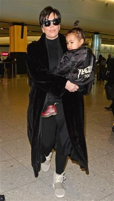 Kris Jenner and North West walk through Heathrow Airport in London on March 2, 2015.