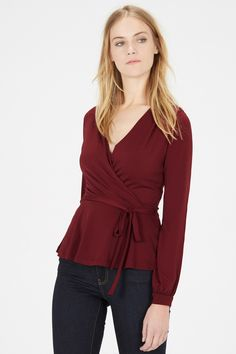 This long sleeves top is constructed from a stretch jersey fabric and features a wrap-over front design, belt loops and a self-tie belt for a defined waist. Length of top, from shoulder seam to hem, approx. Height of model shown: 10 Model wears: UK size Winter Tops For Women, Casual Tops For Women, Red Blouses, Shirt Blouses, Long Sleeve Wrap Top, Party Tops, Oversized Shirt, My Style, How To Wear