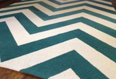 "Use a white Ikea rug.  Use cardboard as your template for a consistent pattern. Cut the cardboard with scissors into a ""V"" shape or ""zig-zag"" pattern for a traditional chevron style. Paint with a roller"