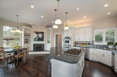 Traditional Kitchen with Raised panel, Stone Tile, Inset cabinets, Pendant light, U-shaped, Breakfast nook, two dishwashers