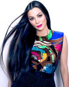 the hair and jewel toned outlook look BEAUTIFUL on her! - Television host China Chow stars in the spring-summer cover story of Vogue China's Collections supplement,