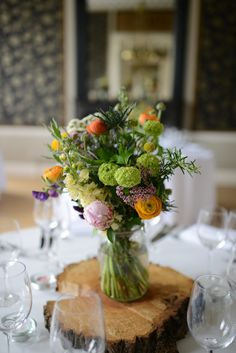 Wild Flowers and Wood Slices for our table centrepieces