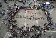 """Members of Peta and Anima Naturalis lie on the street to spell out """"Stop Bullfights"""" during a protest in front of the town hall in PamplonaPhotograph: Rafa Rivas/AFP/Getty Images"""