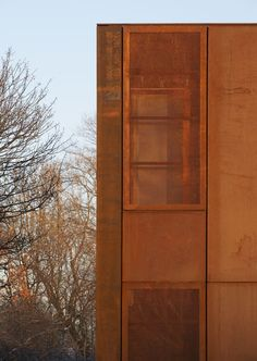 window screened behind perforated panel.  Hackney Marshes Centre by Stanton Williams