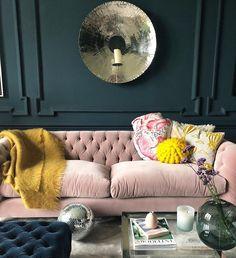 Blush velvet against dark walls