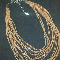 St. Thomas necklace Beautiful St. Thomas multiple leather string and silver bead. The color is like the second picture.  Worn once. St Thomas  Jewelry Necklaces