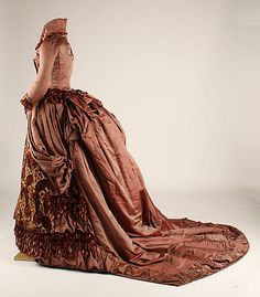 Brocade and satin gown with chenille fringe trim (side view), American, ca. 1879.