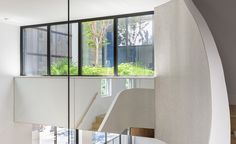 Young Projects saw an empty backyard in Williamsburg as an opportunity to completely evolve an existing townhouse with a floating extension, an internal second floor courtyard full of greenery and an unfurling rooftop terrace with views to Manhattan. T...