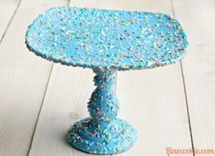 Sprinkle Cake Stand - so cute. Would use round sprinkles. It's not food safe or waterproof. Would use a doily or only use it for cupcakes (not let food directly touch the stand). Such a cute idea - specially for those of us in love with sprinkles