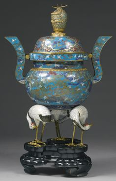 A RARE AND IMPRESSIVE PAIR OF CLOISONNE ENAMEL CENSERS AND COVERS QING DYNASTY, 18TH / EARLY 19TH CENTURY