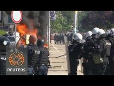Kosovo Albanians torch cars, police fire rubber bullets in divided town