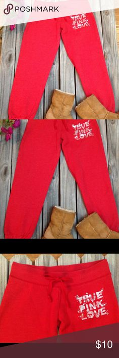 """PINK Victoria's Secret red capri sweatpants sz S ° Brand: Victoria's Secret PINK  ° Item: """"my favorite sweats"""" capris ° Size: small ° Color: red, slightly faded and  ° Condition: worn, slight fade, and minor pilling of fabric. No holes or tears, jewels all appear to be intact, and elastic on waist and leg openings is still stretchy! Worn-in, but still comfy with lots of life left! PINK Victoria's Secret Pants Capris"""