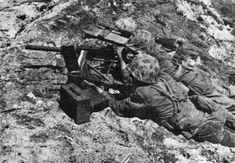 US Marine Corps machine gun crew operating a Browning M1919A4 heavy machine gun, circa early Feb 1944, Marshall Islands Campaign