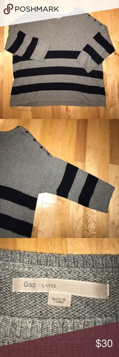 Gap grey and navy sweater Grey and navy sweater. 3/4 sleeves and slightly cropped. Very comfy. Women's size large. This has only been worn a few times. The left sleeve has buttons that do unbutton leading from the neck to the shoulder. GAP Sweaters