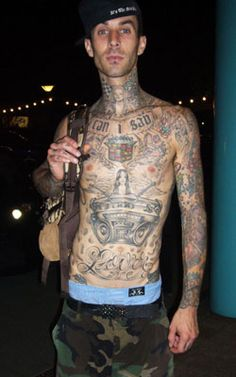 Travis Barker flaunting His Full Sleeve And Body Tattoo Design.