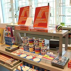 """""""New merchandise for our Corita Kent exhibition is adding pop to our shop display! Gift Shop Displays, Shop Window Displays, Store Displays, Retail Displays, Gift Shop Interiors, Souvenir Store, Harvard Art Museum, Retail Interior, Interior Shop"""