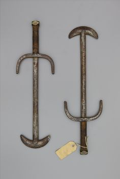 Chinese maces with an unusual crescent shaped heads, circa 1800