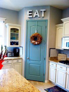Painted  pantry door $10 project. Benjamin Moore Azores  paint color. Idea- Paint pantry door at the cabin