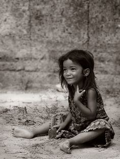 Innocence at Angkor by Craig Martin Cambodian girl playing among the ruins at Angkor Wat
