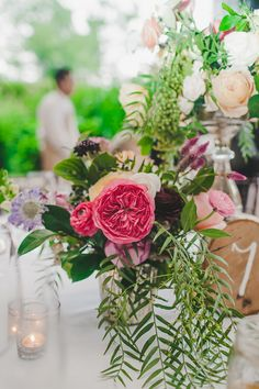 garden rose centerpiece with greenery, photo by Teale Photography http://ruffledblog.com/elegant-rainy-day-wedding #weddingcenterpieces #flowers