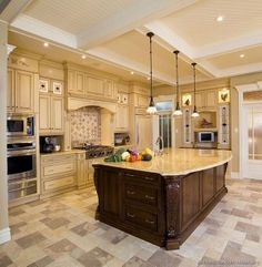 Gorgeous island and flooring in this large kitchen!  #kitchens  #kitchenislands  homechanneltv.com