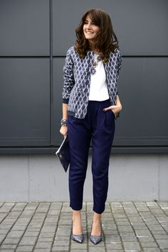 Navy pants, white shirt, grey printed cardigan, silver shoes, jewelry