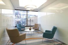 A large window floods this breakout area with natural light & showcases the central London surroundings