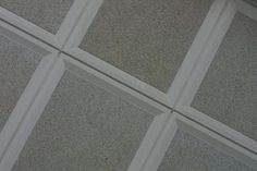Acoustical tiles have sound absorption qualities that help reduce noises in a room. Manufacturers market a number of different tile profiles and styles under the broad category of acoustical tiles. A ...