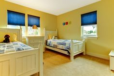 Cute and cozy kids bedroom in yellow and blue. #Kids #Bedroom #Designs