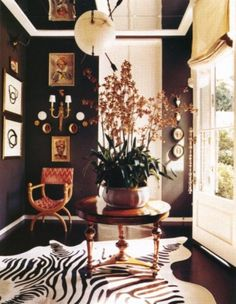 Orchids by Wearstler.  Black walls recede while light colors in front of it pull forward giving more depth to the small room