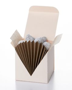 """Folded Favor Box: To give your favors an Art Deco look, cut a V shape into the front of the box with scissors, starting at the top front corners. Glue a fan made from a 8 paper rectangle into the open space. Line the box with colored tissue paper. Wedding Favor Boxes, Wedding Party Favors, Wedding Gifts, Wedding Spot, Plan Your Wedding, Wedding Unique, Wedding Ideas, Free Wedding, Diy Wedding"