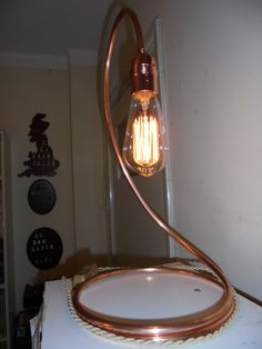 Copper lamp on Etsy. Looks easy enough to make and top off with an Edison bulb. Pipe Lighting, Cool Lighting, Lighting Design, Deco Luminaire, Copper Lamps, Deco Originale, Steampunk Lamp, Outdoor Light Fixtures, Pipe Lamp
